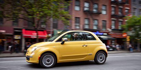 Tire, Motor vehicle, Wheel, Automotive design, Vehicle, Yellow, Road, Transport, Rim, Car,