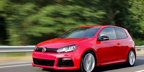 Automotive design, Daytime, Vehicle, Car, Red, Automotive wheel system, Hatchback, Alloy wheel, Rim, Bumper,