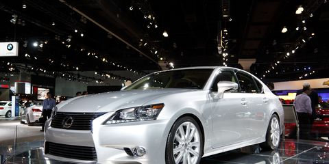 Wheel, Automotive design, Vehicle, Event, Land vehicle, Car, Glass, Headlamp, Auto show, Personal luxury car,