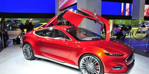Tire, Wheel, Automotive design, Vehicle, Land vehicle, Alloy wheel, Car, Auto show, Exhibition, Performance car,