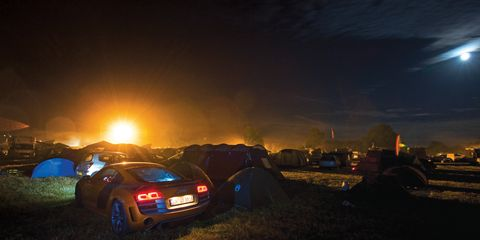 Automotive tail & brake light, Automotive lighting, Night, Atmosphere, Vehicle registration plate, Car, Automotive exterior, Midnight, Luxury vehicle, Mid-size car,