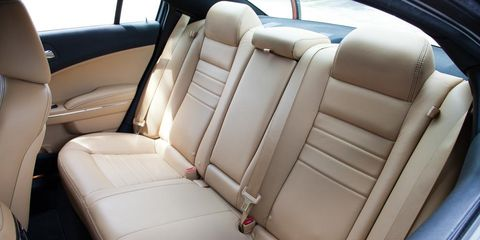 Motor vehicle, Mode of transport, Car seat, Car seat cover, Head restraint, Vehicle door, Seat belt, Luxury vehicle, Family car, Leather,