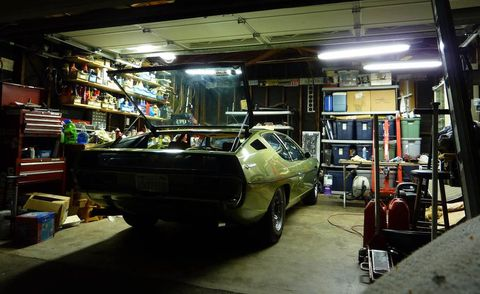 Motor vehicle, Automotive exterior, Automotive parking light, Fender, Garage, Workshop, Shelf, Machine, Bumper, Auto part,
