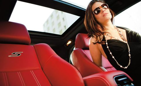 Eyewear, Motor vehicle, Vision care, Glasses, Automotive design, Red, Sunglasses, Goggles, Vehicle door, Car seat,