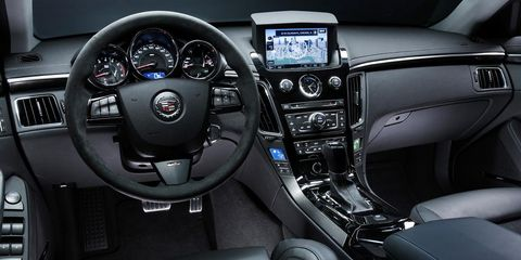 Motor vehicle, Steering part, Mode of transport, Product, Automotive design, Steering wheel, Center console, Vehicle audio, White, Technology,
