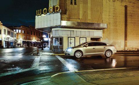 Window, Car, Alloy wheel, Commercial building, Automotive parking light, Full-size car, Mid-size car, Metropolitan area, Sedan, Luxury vehicle,