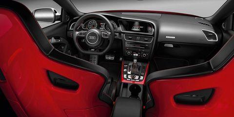 Motor vehicle, Steering part, Steering wheel, Automotive design, Center console, Red, Vehicle audio, Speedometer, Gauge, Trip computer,