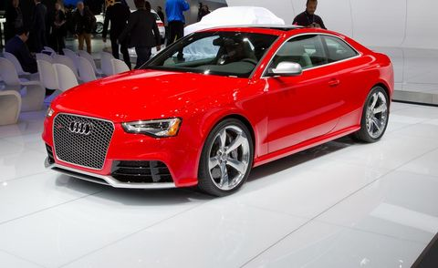 Tire, Wheel, Automotive design, Vehicle, Event, Land vehicle, Car, Grille, Red, Alloy wheel,