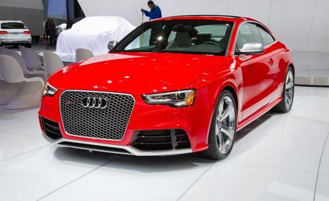 Automotive design, Vehicle, Event, Land vehicle, Grille, Car, Red, Alloy wheel, Personal luxury car, Luxury vehicle,