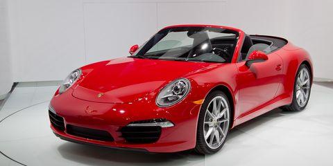 Tire, Wheel, Automotive design, Vehicle, Land vehicle, Car, Performance car, Red, Rim, Automotive lighting,