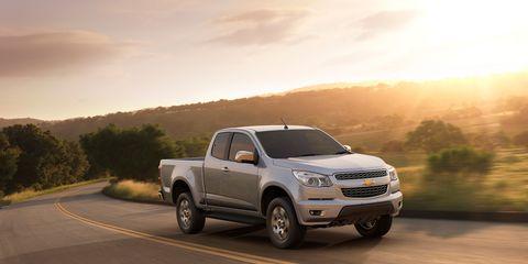 Motor vehicle, Wheel, Vehicle, Automotive tire, Land vehicle, Automotive design, Road, Rim, Landscape, Car,