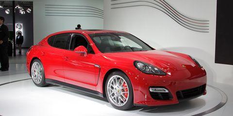 Wheel, Automotive design, Vehicle, Land vehicle, Car, Performance car, Red, Fender, Sports car, Automotive lighting,