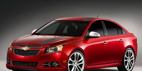 Tire, Wheel, Motor vehicle, Automotive design, Automotive mirror, Vehicle, Transport, Automotive lighting, Car, Red,