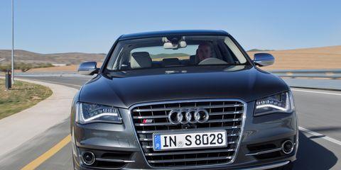 Motor vehicle, Automotive design, Road, Vehicle, Vehicle registration plate, Land vehicle, Grille, Headlamp, Automotive exterior, Infrastructure,