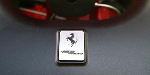 Motor vehicle, Logo, Symbol, Carmine, Material property, Emblem, Circle, Coquelicot, Sign, Trademark,
