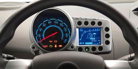 Motor vehicle, Mode of transport, Transport, Speedometer, Gauge, Tachometer, Trip computer, Steering wheel, Grey, Measuring instrument,