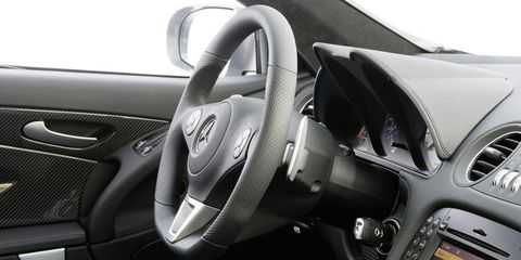 Motor vehicle, Automotive design, Steering part, Steering wheel, White, Grey, Luxury vehicle, Speedometer, Center console, Personal luxury car,