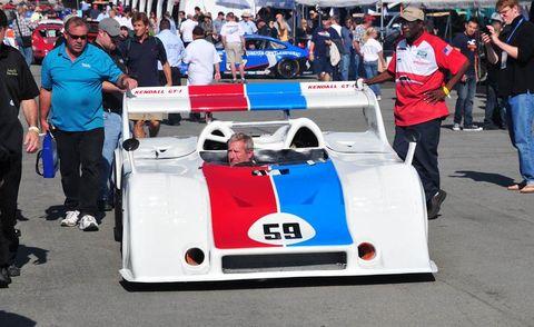 Automotive design, Vehicle, Hat, Race car, Sports prototype, Sports car, Motorsport, Race track, Racing, Umbrella,