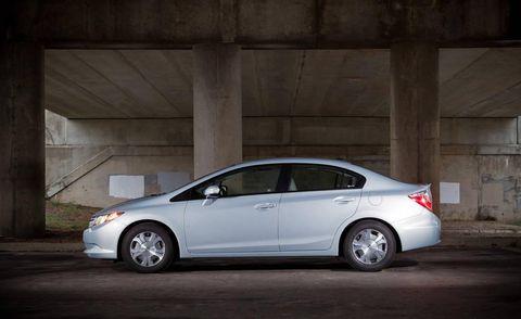 Wheel, Tire, Automotive design, Vehicle, Land vehicle, Car, Rim, Alloy wheel, Automotive parking light, Full-size car,