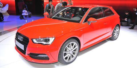 Tire, Wheel, Automotive design, Vehicle, Event, Car, Alloy wheel, Red, Grille, Audi,