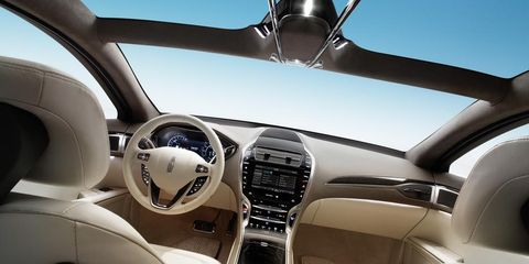 Motor vehicle, Mode of transport, Automotive design, White, Steering wheel, Steering part, Luxury vehicle, Personal luxury car, Design, Center console,