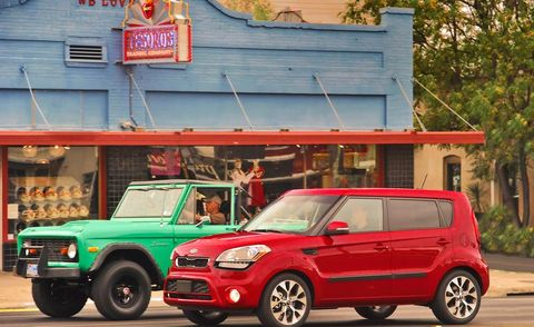 Wheel, Tire, Motor vehicle, Automotive design, Vehicle, Land vehicle, Car, Red, Vehicle door, Automotive mirror,