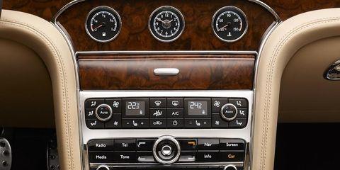 Center console, Radio, Vehicle audio, Luxury vehicle, Steering part, Steering wheel, Personal luxury car, Gauge, Bentley, Gear shift,
