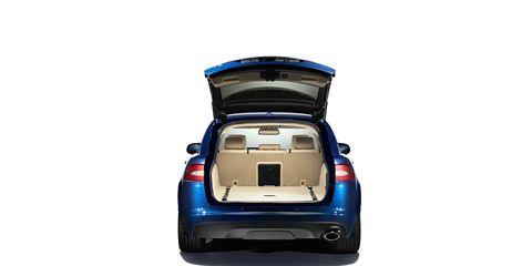 Motor vehicle, Automotive tail & brake light, Automotive design, Automotive exterior, Automotive lighting, Trunk, Bumper, Electric blue, Vehicle door, Automotive mirror,