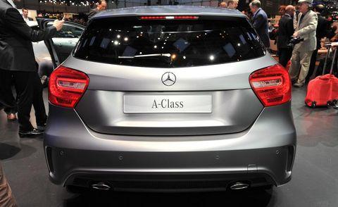 Automotive design, Vehicle, Land vehicle, Car, Vehicle registration plate, Automotive exterior, Hatchback, Bumper, Logo, Luxury vehicle,
