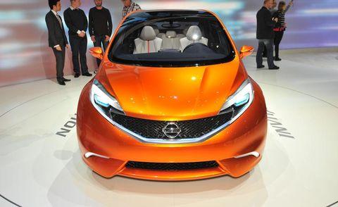 Automotive design, Event, Vehicle, Land vehicle, Car, Auto show, Exhibition, Amber, Personal luxury car, Orange,