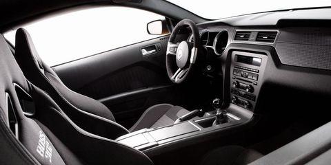 Motor vehicle, Steering part, Automotive design, Vehicle, Steering wheel, Automotive mirror, White, Car, Center console, Vehicle audio,