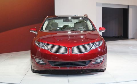 Automotive design, Vehicle, Event, Grille, Automotive lighting, Car, Personal luxury car, Full-size car, Hood, Glass,