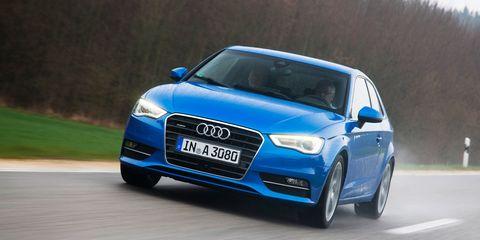 Motor vehicle, Automotive design, Automotive mirror, Blue, Daytime, Road, Vehicle, Infrastructure, Vehicle registration plate, Headlamp,