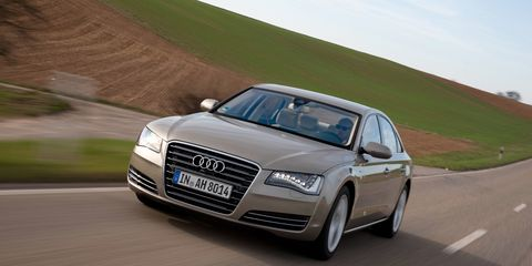 Automotive design, Road, Mode of transport, Vehicle, Headlamp, Grille, Automotive parking light, Infrastructure, Automotive exterior, Automotive mirror,