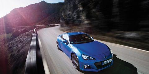 Automotive design, Road, Vehicle, Land vehicle, Car, Automotive lighting, Automotive mirror, Rim, Performance car, Fender,