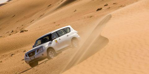 Sand, Automotive design, Natural environment, Erg, Aeolian landform, Automotive exterior, Desert, Landscape, Dune, Car,