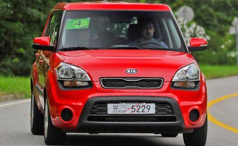 Motor vehicle, Automotive design, Vehicle, Road, Land vehicle, Hood, Headlamp, Red, Transport, Car,