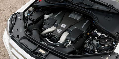 Automotive design, Automotive exterior, Engine, Hood, Personal luxury car, Bumper, Luxury vehicle, Grille, Performance car, Automotive engine part,