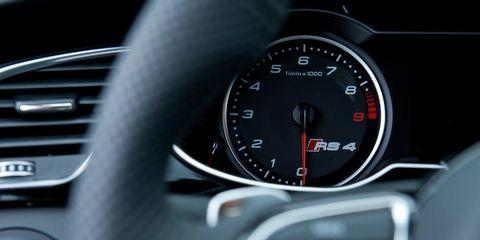 Motor vehicle, Automotive design, Speedometer, Gauge, Black, Measuring instrument, Steering wheel, Tachometer, Luxury vehicle, Symbol,