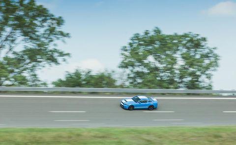 Road, Automotive design, Asphalt, Road surface, Race track, Motorsport, Car, Plain, Automotive tire, Racing,