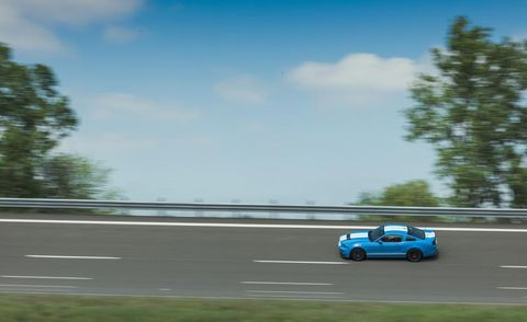 Blue, Automotive design, Road, Sky, Infrastructure, Motorsport, Asphalt, Car, Plain, Road surface,