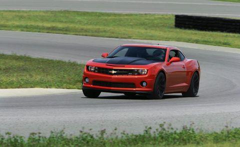 Tire, Road, Automotive design, Vehicle, Land vehicle, Automotive lighting, Automotive tire, Infrastructure, Chevrolet camaro, Car,
