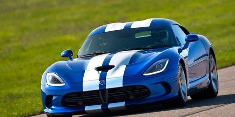 Automotive design, Blue, Grass, Vehicle, Hood, Headlamp, Car, Rallying, Race track, Sports car racing,