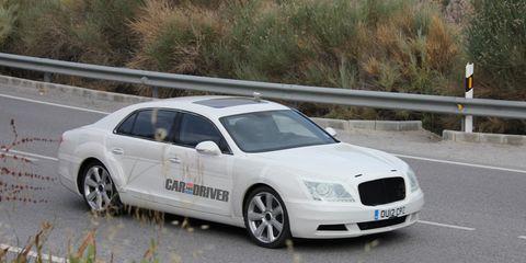 Tire, Wheel, Vehicle, Road, Land vehicle, Infrastructure, Car, Rim, Hood, Alloy wheel,