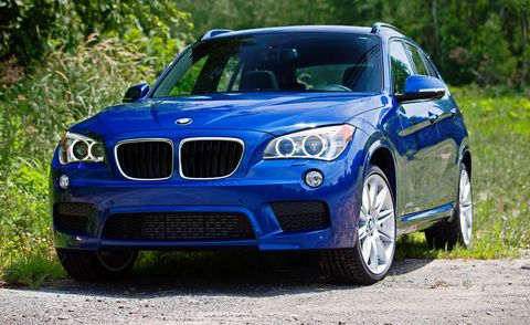 Automotive design, Blue, Vehicle, Land vehicle, Hood, Car, Grille, Rim, Automotive lighting, Automotive exterior,