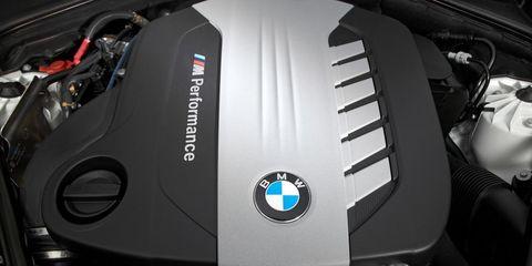 Motor vehicle, Motorcycle, Automotive design, Automotive exterior, Motorcycle accessories, Logo, Carbon, Automotive fuel system, Engine, Personal luxury car,