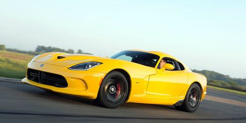 Tire, Automotive design, Mode of transport, Yellow, Vehicle, Infrastructure, Road, Performance car, Car, Rim,