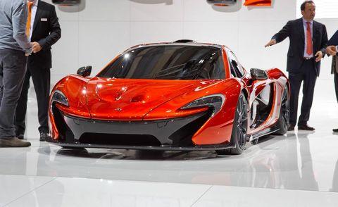 Automotive design, Vehicle, Land vehicle, Event, Trousers, Car, Coat, Suit, Supercar, Auto show,