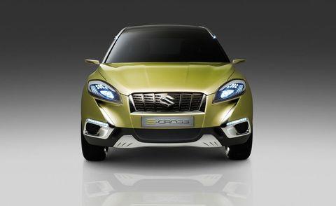 Motor vehicle, Automotive design, Automotive mirror, Product, Automotive lighting, Vehicle, Yellow, Automotive exterior, Headlamp, Grille,