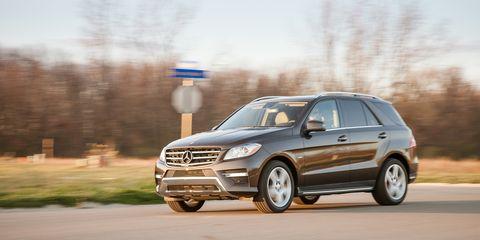 Tire, Wheel, Automotive design, Vehicle, Automotive tire, Land vehicle, Road, Automotive mirror, Automotive parking light, Transport,